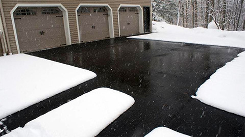 Heated asphalt driveway and walkways.